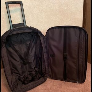 Tumi Carry-On Roller Bag